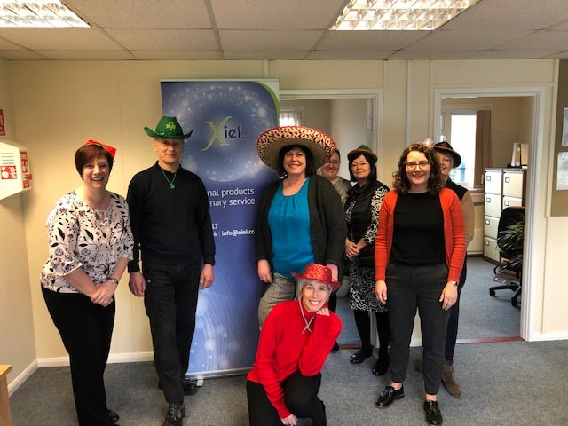 Xiel team promoting Wear A Hat Day